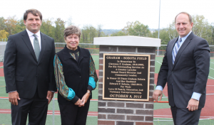 Diane Graham Sobota, along with her sons Michael (left) and Ed, unveiled the new field marker for Graham-Sobota Field on October 9, 2015